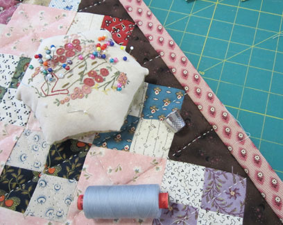 Pink-patches-doll-quilt-bin