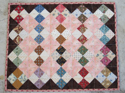 Pink-patches-doll-quilt-fin